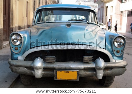 HAVANA - 25 MARCH: Vintage car in Cuba, Havana, March 25, 2007. October 2011, Cuban people finally got the right to trade on buying and selling cars. Ban on trade with cars was introduced in 1959.
