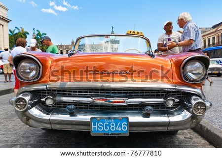 HAVANA-MAY 3: Front view of an old Chevrolet on May 3, 2011 in Havana, Cuba. Cubans keep thousands of classic cars like this running despite their age & lack of parts. They've become an world known icon of the country. - stock photo