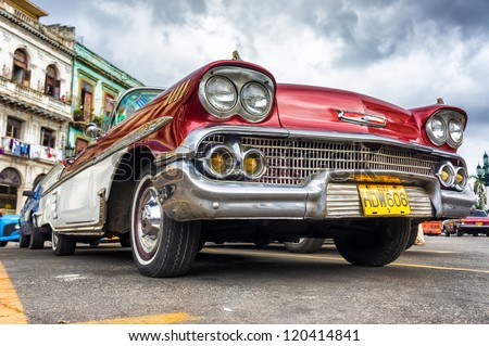 HAVANA-NOVEMBER 28:Low angle view of an old Chevrolet November 28,2012 in Havana.Thousands of these cars are still in use in Cuba and they have become an iconic view and a worldwide known attraction - stock photo