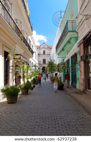 HAVANA - SEPTEMBER 26:Cubans walk down a typical street in Old Havana October 12, 2010 in Havana.Old Havana, declared a UNESCO World Heritage Site, is the most visited part of the city by tourists - stock photo