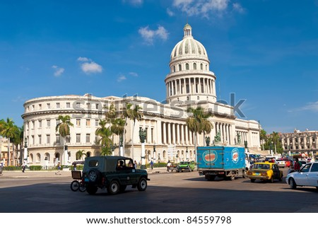 HAVANA-SEPTEMBER 12:Traffic in front of the Capitol September 12,2011 in Havana.Built in 1929 to house the island's Senate and House of Representatives,the Capitol dominates the skyline of Havana. - stock photo