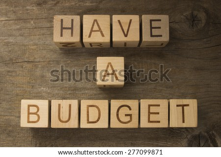 Have a budget on a wooden background