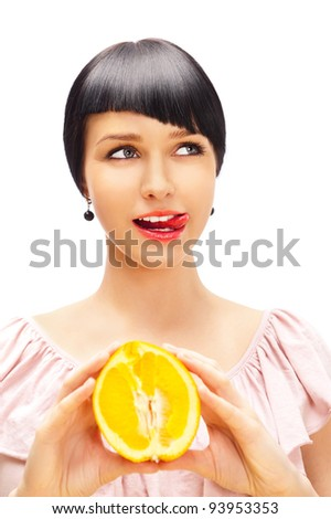 Have a lick. Pretty woman with delicious orange in her arms. - stock photo