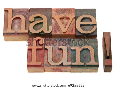 have fun exclamation in vintage wooden letterpress printing blocks, stained by color inks, isolated on white - stock photo
