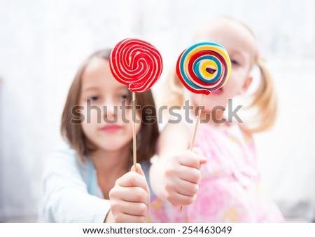 have fun with colored lollipops - stock photo