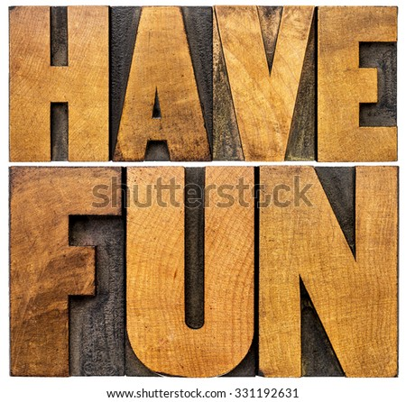 have fun word abstract - isolated text in vintage letterpress wood type blocks - stock photo