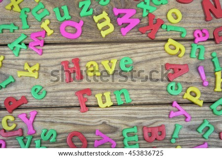 Have Fun word on wooden table