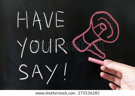 Have your say words written on blackboard using chalk - stock photo