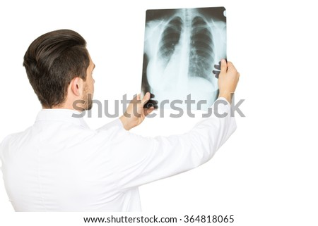 Having a look at your problem. Professional doctor examining an x-ray isolated on white copyspace on the side  - stock photo