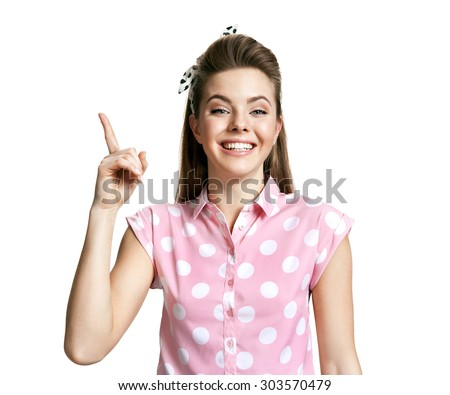 Having an idea woman pointing finger up and looking at camera / photo of young cheerful brunette woman over white background, positive emotions - stock photo