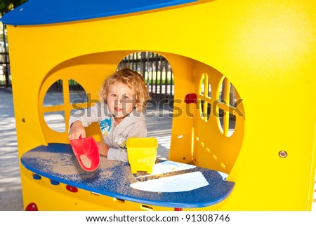 Having fun at playground in the park on Sunday morning. - stock photo