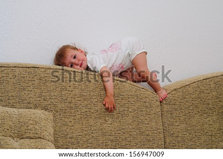 Having fun, Baby is playing on the sofa - stock photo
