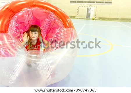having fun playing bumper ball indoors - stock photo