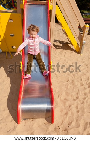 Having fun playing on playground on sunny morning. - stock photo