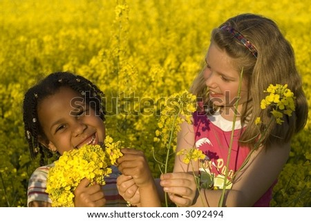 Having fun while picking flowers - stock photo