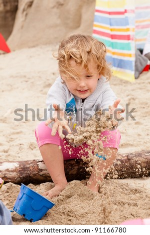 Having fun with sand on the beach. - stock photo