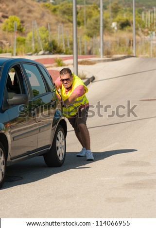 Having to push uphill after a breakdown - stock photo