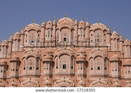 Hawa Mahal or Palace of the Winds. Ornate pink facade built to allow ladies of the Royal Court to look into the street without being seen. Jaipur, Rajasthan, India - stock photo