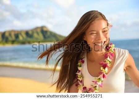 Hawaii beach woman happy on Hawaiian holidays. Portrait of cheerful young Asian adult laughing of fun during her travel summer vacation in Waikiki beach, Honolulu, Oahu, Hawaii, USA. - stock photo