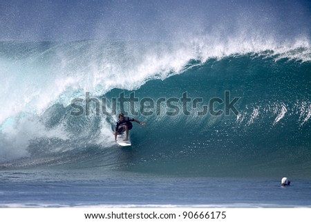 HAWAII - DECEMBER 9: Australian Keiren Perrow wins the Billabong Pipemasters on December 9, 2011 at Pipeline, Hawaii. This years event produced some of the biggest waves in recent years. - stock photo