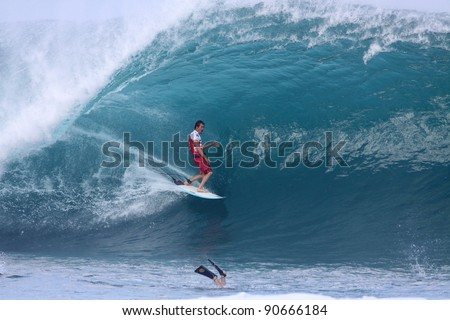 HAWAII - DECEMBER 9: Damien Hobgood competes in the Billabong Pipemasters on December 9, 2011 at Pipeline, Hawaii. This years event produced some of the biggest waves in recent years. - stock photo