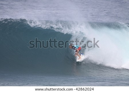 HAWAII- DECEMBER 10: Three times World Champ Andy Irons competes in the Billabong Pipemasters Dec. 10, 2009 in Hawaii. - stock photo