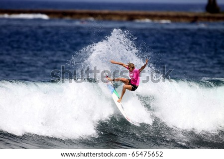 HAWAII - NOV.17: Stephanie Gilmore competes in the Cholo's Women's Hawaiian Pro  November 17, 2010 at Haleiwa Beach, Hawaii. She is the women's world champ and was the winner of this event. - stock photo