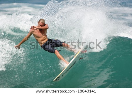 Hawaii - Oct. 29: Pro surfer Flynn Novak executes a nice carve during the begining of the winter season on Oct.29, 2007 at Rocky Point, Hawaii. - stock photo