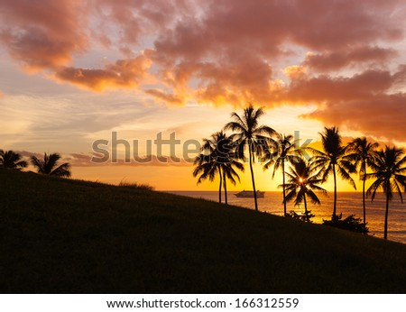 Hawaii paradise beach sunset with palm trees. Summer travels holiday vacation gateway,  - stock photo