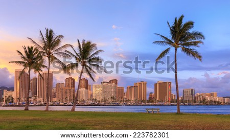 Hawaii skyline and palm trees at sunset