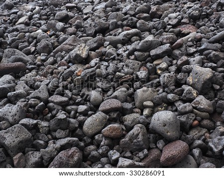 Hawaiian Beach of Worn Lava Rock - stock photo