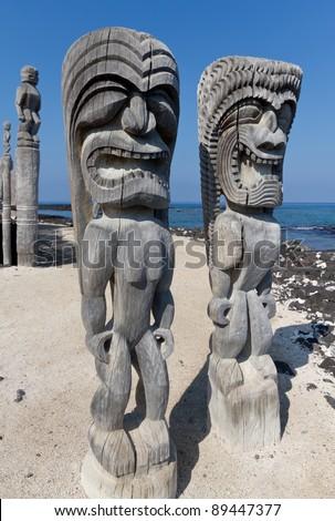 Hawaiian City of Refuge Tiki statue at Honaunau - stock photo