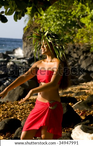 Hawaiian girl dancing Hula on a beach in Kauai - stock photo