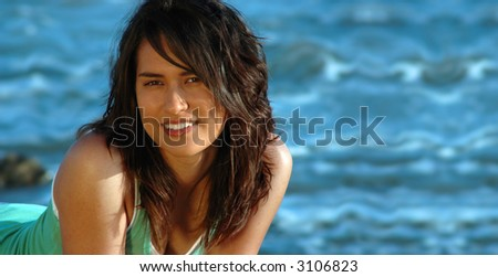 Hawaiian girl on a tropical beach, with a banner of space available for copy - stock photo
