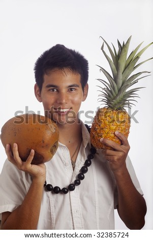 Hawaiian man wearing a kukui nut lei holds a pineapple and a coconut - stock photo