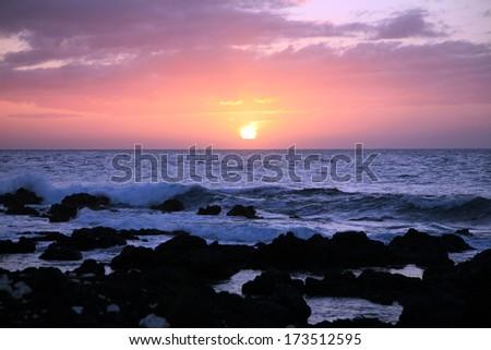 Hawaiian sunset off the Kohala Coast of the Big Island of Hawaii/Waikoloa Sunset/End of a perfect day - stock photo