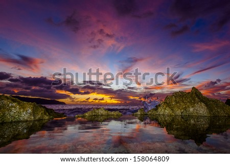 Hawaiian Sunset on Oahu's North Shore - stock photo