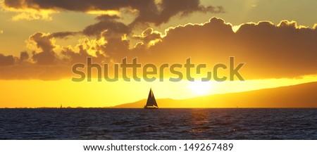 Hawaiian sunset over Ocean off of Waikiki Beach on Oahu, Hawaii - stock photo