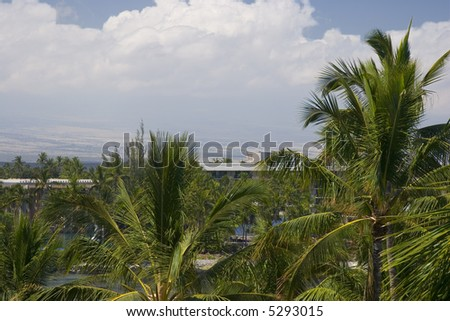 Hawaiian Volcanic Mountains on Kona Island covered with White Clouds