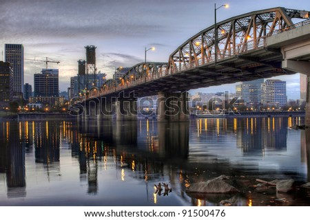 Hawthorne Bridge Across Willamette River with Portland Oregon Skyline Downtown Waterfront - stock photo