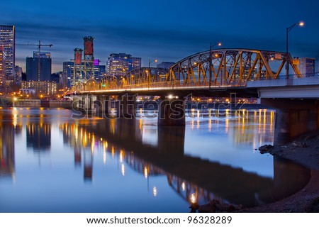 Hawthorne Bridge Over Willamette River In Portland Oregon Downtown Waterfront at Blue Hour - stock photo