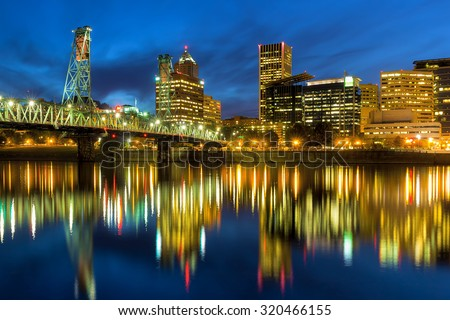 Hawthorne Bridge Over Willamette River in Portland Oregon during Evening Blue Hour - stock photo