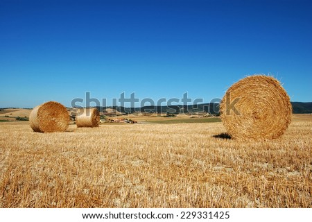 Hay bales in a blue sky