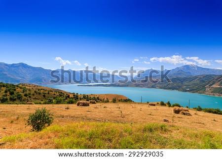 Hay bales, mountains, the landscape of Uzbekistan - stock photo