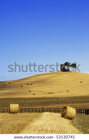 Hay Bales on a yellow field in the tuscany country - stock photo