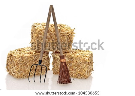 Hay bales with tools on a white background - stock photo