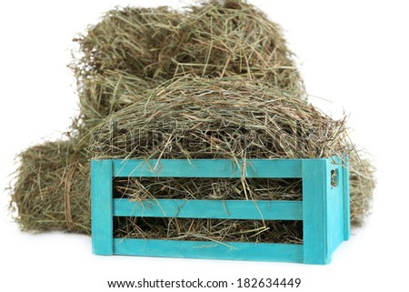Hay in wooden crate, isolated on white - stock photo