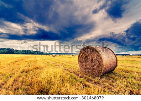 Haystack in the field before the storm. Image in the yellow-blue toning