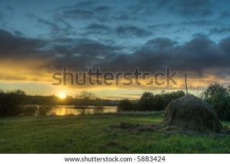 haystack on coast - stock photo