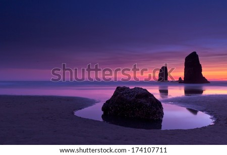 Haystack Rock at sunset Cannon Beach Oregon - stock photo